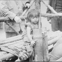 Girl from Philippines. she was displayed at the Coney Island Zoo. She was a zoo attraction among the monkeys and lizards. she was bound by ropes. visitors threw her peanuts. 1914 [720x439]