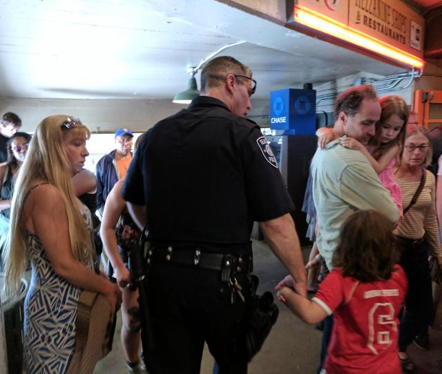 Seattle Pd Escorts A Lost Child Through Pike Place Market