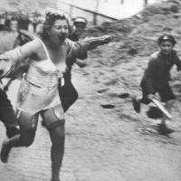 Jewish woman chased by men and youth armed with clubs during the Lviv pogroms, Lviv Ukraine, 1941 [1168x1600]