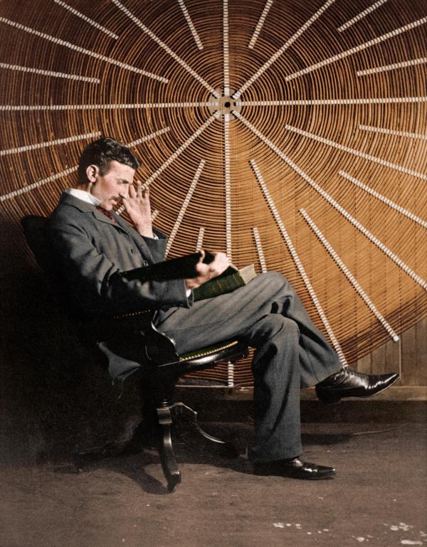 Nikola Tesla, with Roger Boskovich's book 'Theoria ...