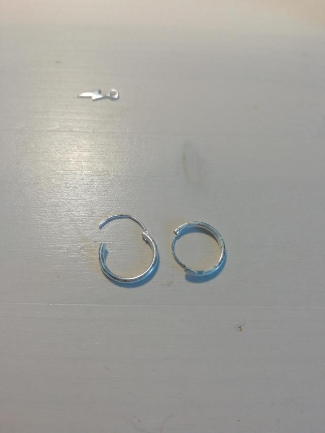 Put sterling silver earrings in salt water to clean them, and now