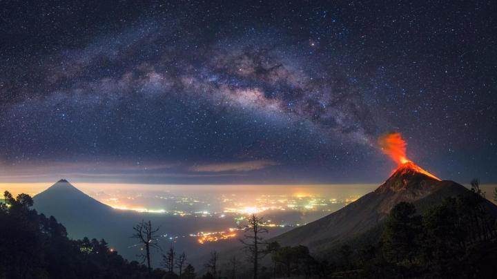 The milky way coming out of an erupting volcano [1366×768]