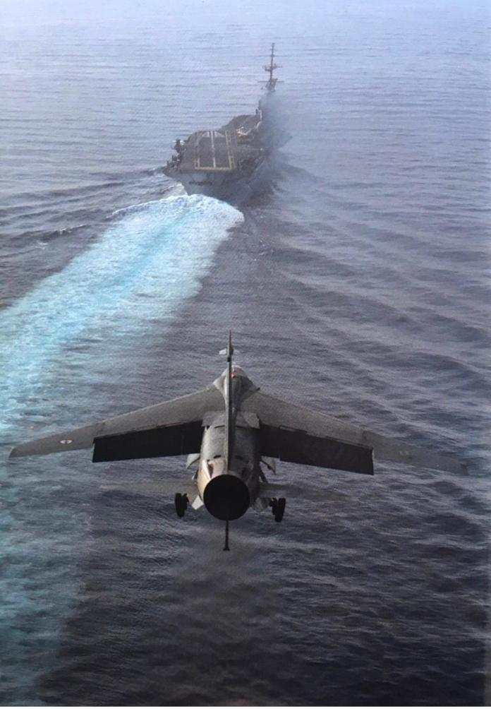 A Vought F-8 Crusader lines up for landing on the French aircraft carrier  Foch (R99). Date and location unknown. [1242 × 1792]: WarshipPorn