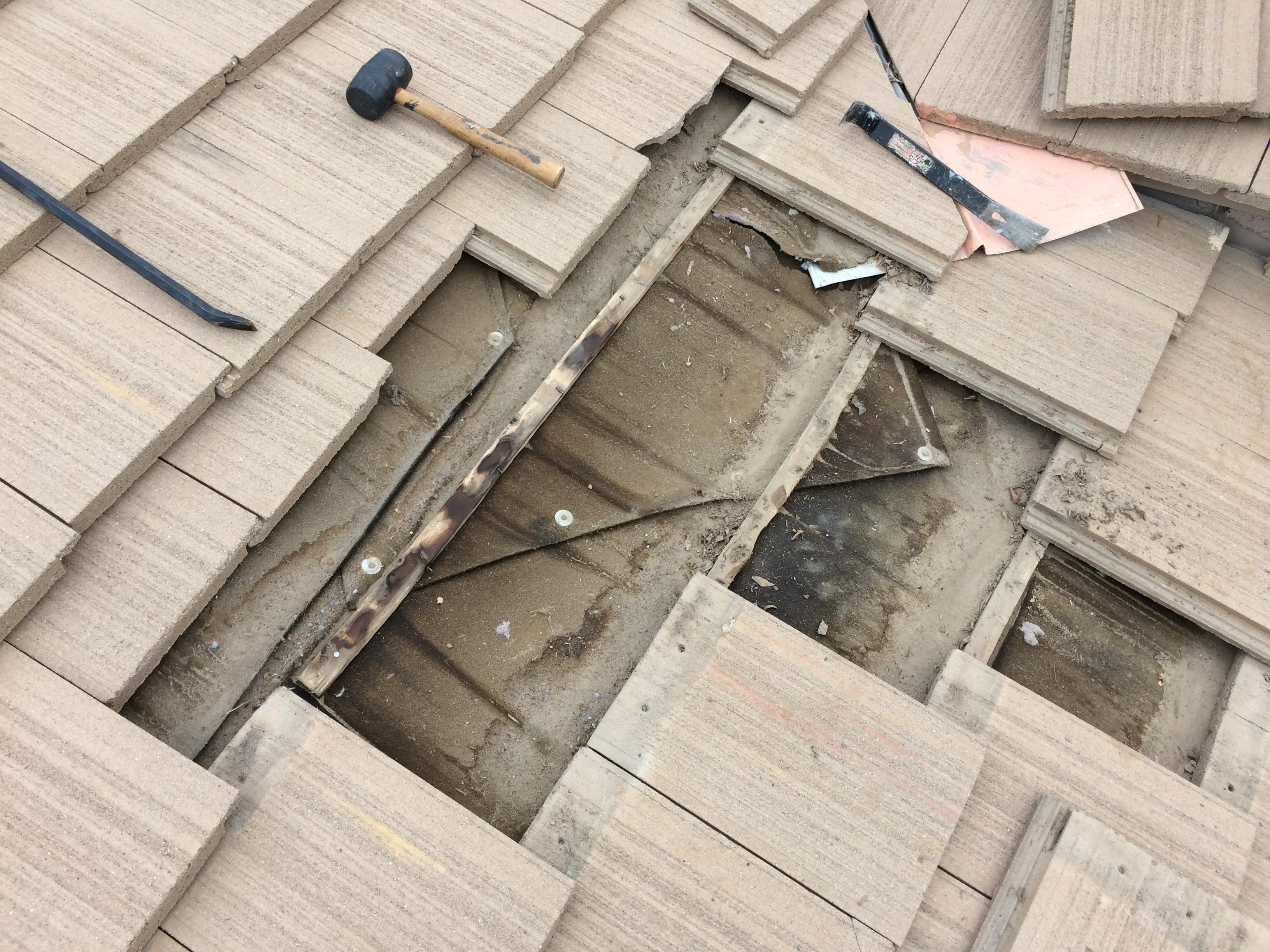leak in cement tile roof need some