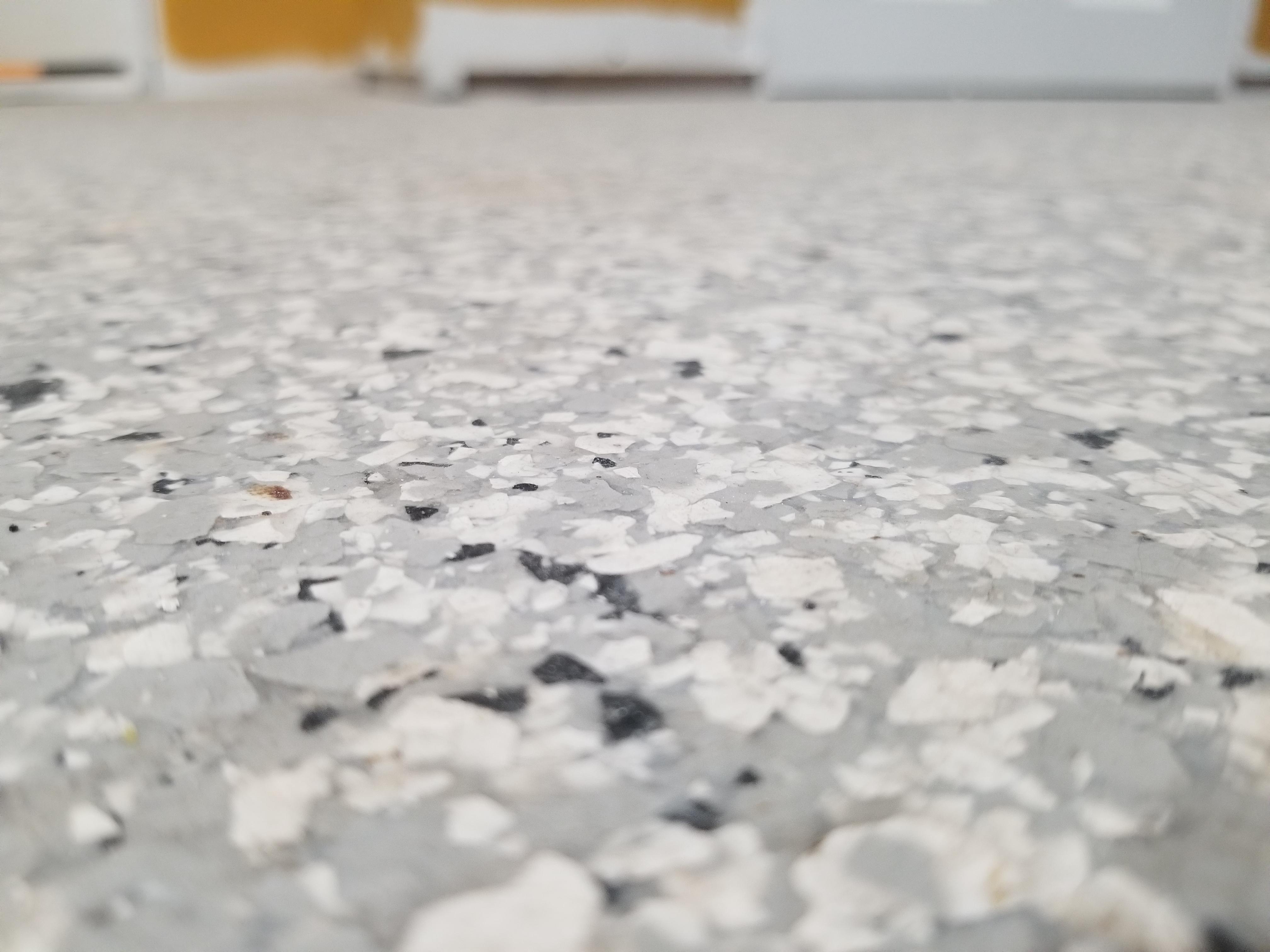 peel vinyl tile over this epoxy floor