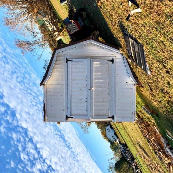 overturned shed after tornado in gum creek tennessee