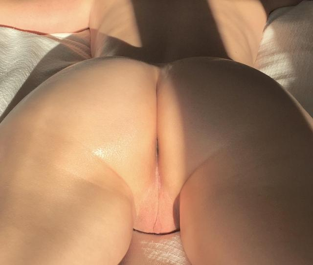 Showing Off Her Smooth Ass And Pussy