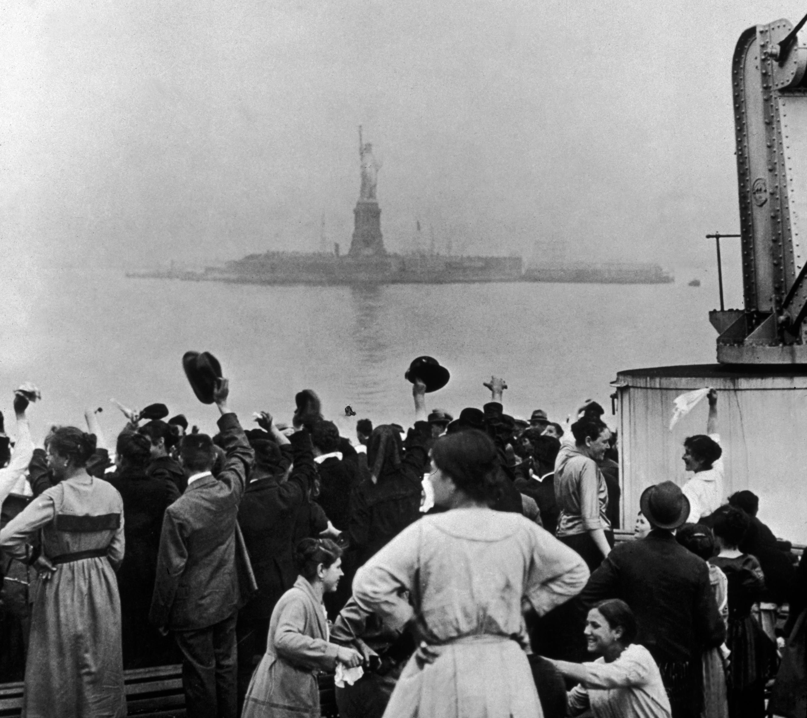 Immigrants Celebrate Seeing The Statue Of Liberty As Their