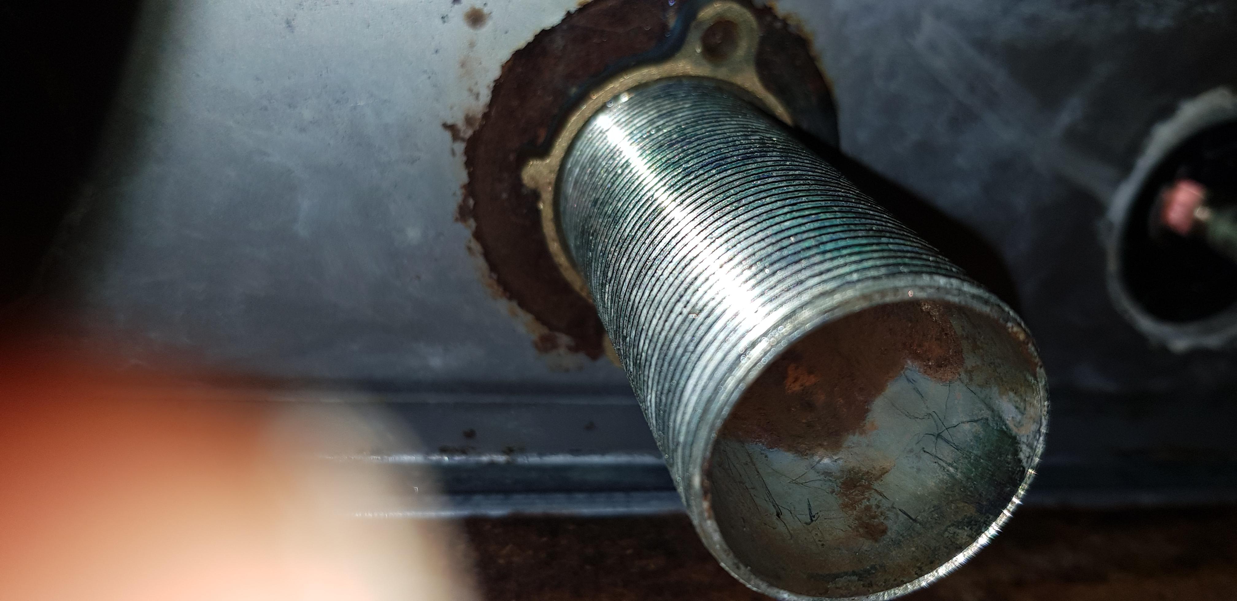 how do i remove a stuck faucet lock nut