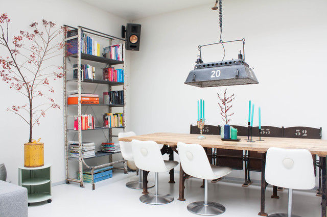gorgeous white modern interior with a industrial lamp hanging from the ceiling
