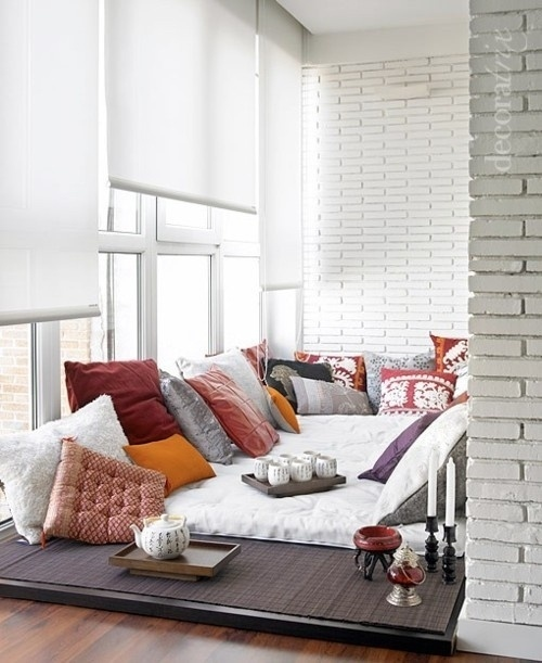 Mattress On Floor And Tons Of Pillows Are Used For This Cozy Nook