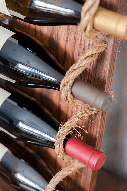 Chic DIY Rustic Wine Rack With Rope Shelterness
