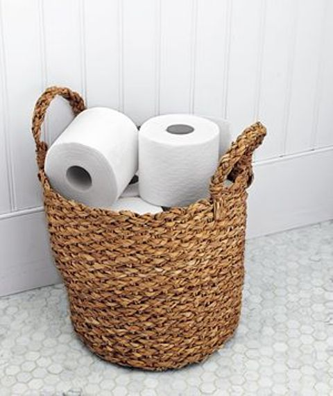 26 Cool Ways To Use Baskets At Home Decor   Shelterness a woven basket holds an ample supply of toilet paper