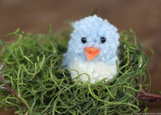 DIy blue pompom birdie for Easter decor (via www.themagiconions.com)