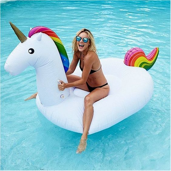 funny unicorn pool float with a horn and colorful details