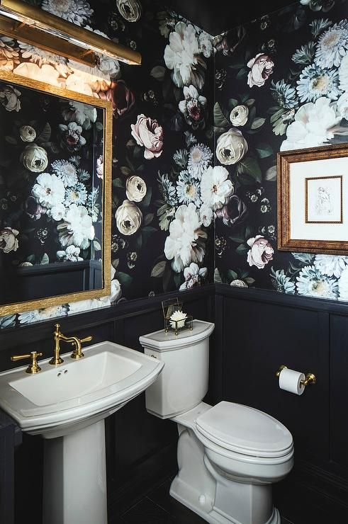 moody floral wallpaper makes this bathroom trendy because dark decor is a hot trend