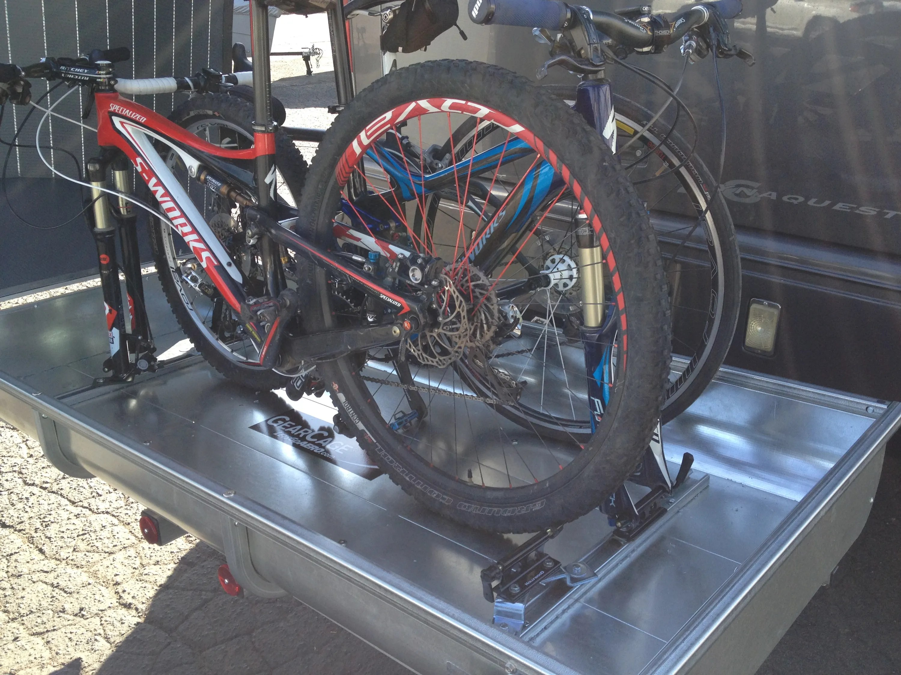 enclosed bicycle hitch carrier holds an