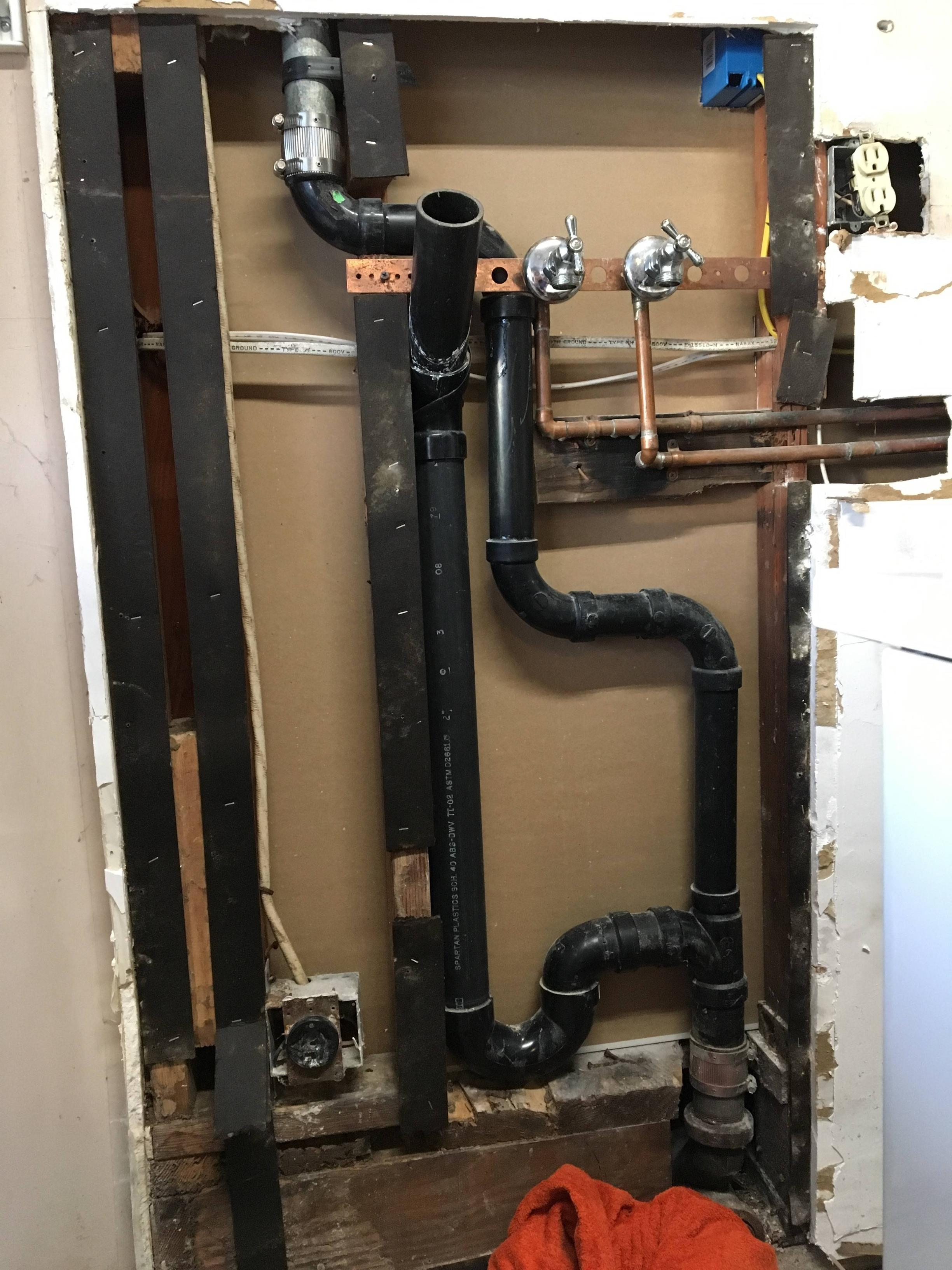 utility sink drain into a tight space