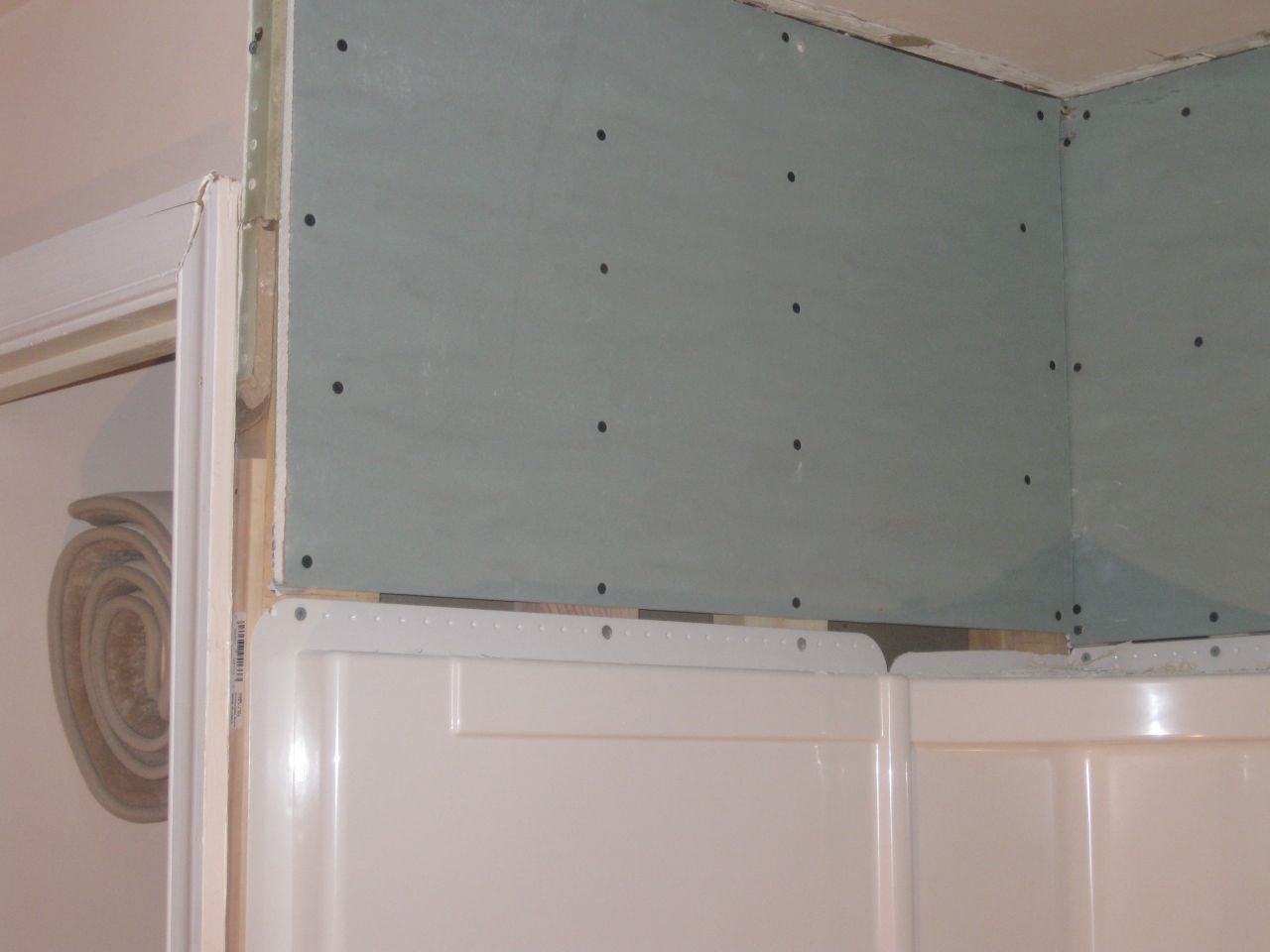 how to tile over shower wall surround