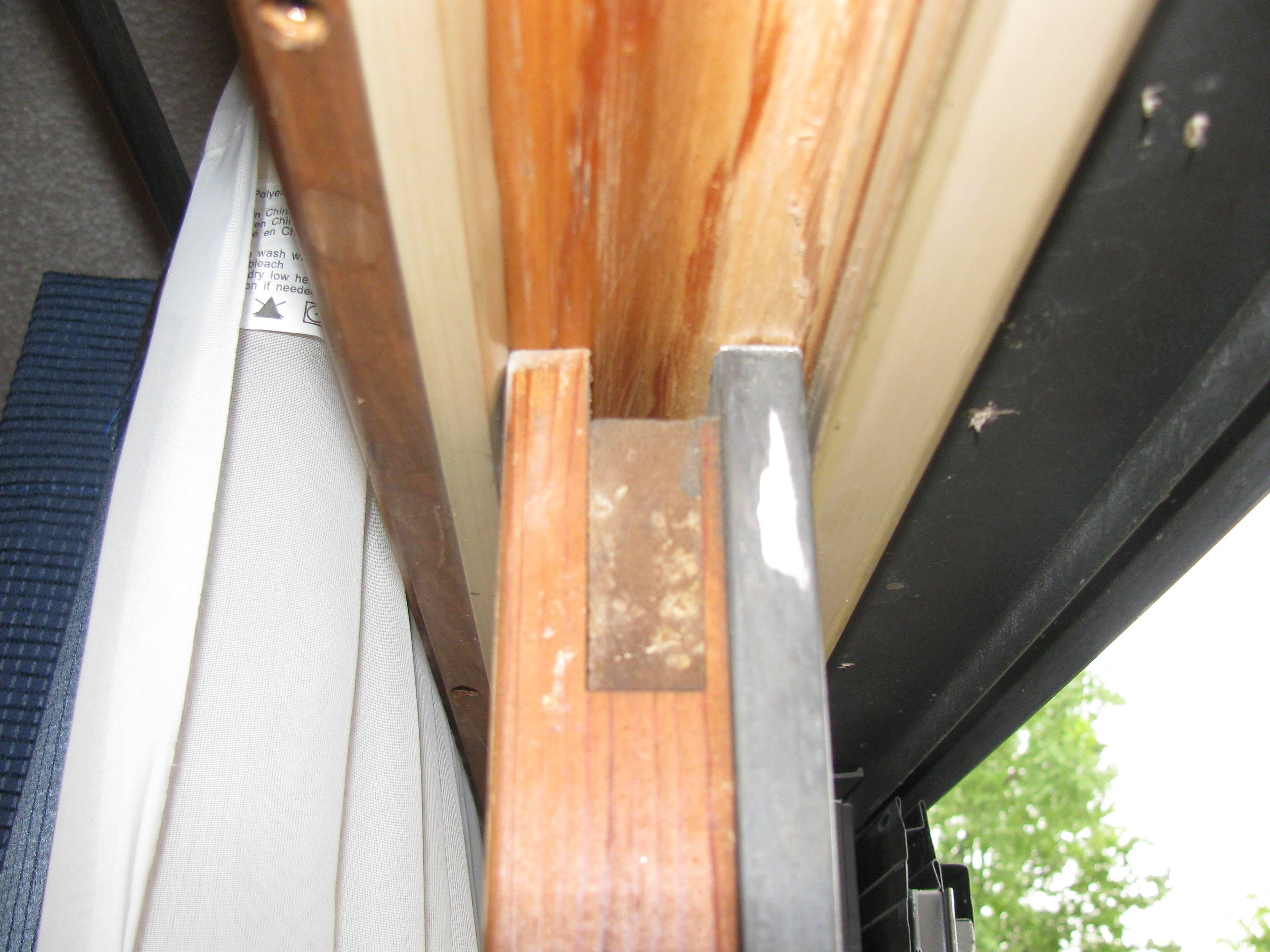 sliding wooden patio door getting