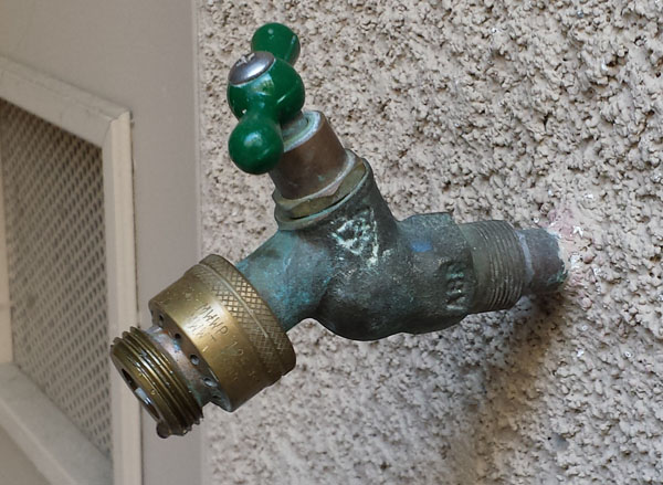 leaky outdoor faucet when using spray