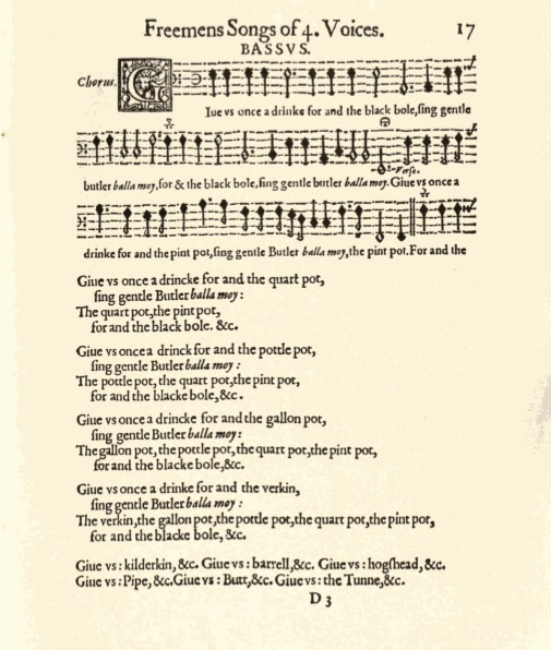 old parchement with sheet music on the upper half, and lyrics on the lower half
