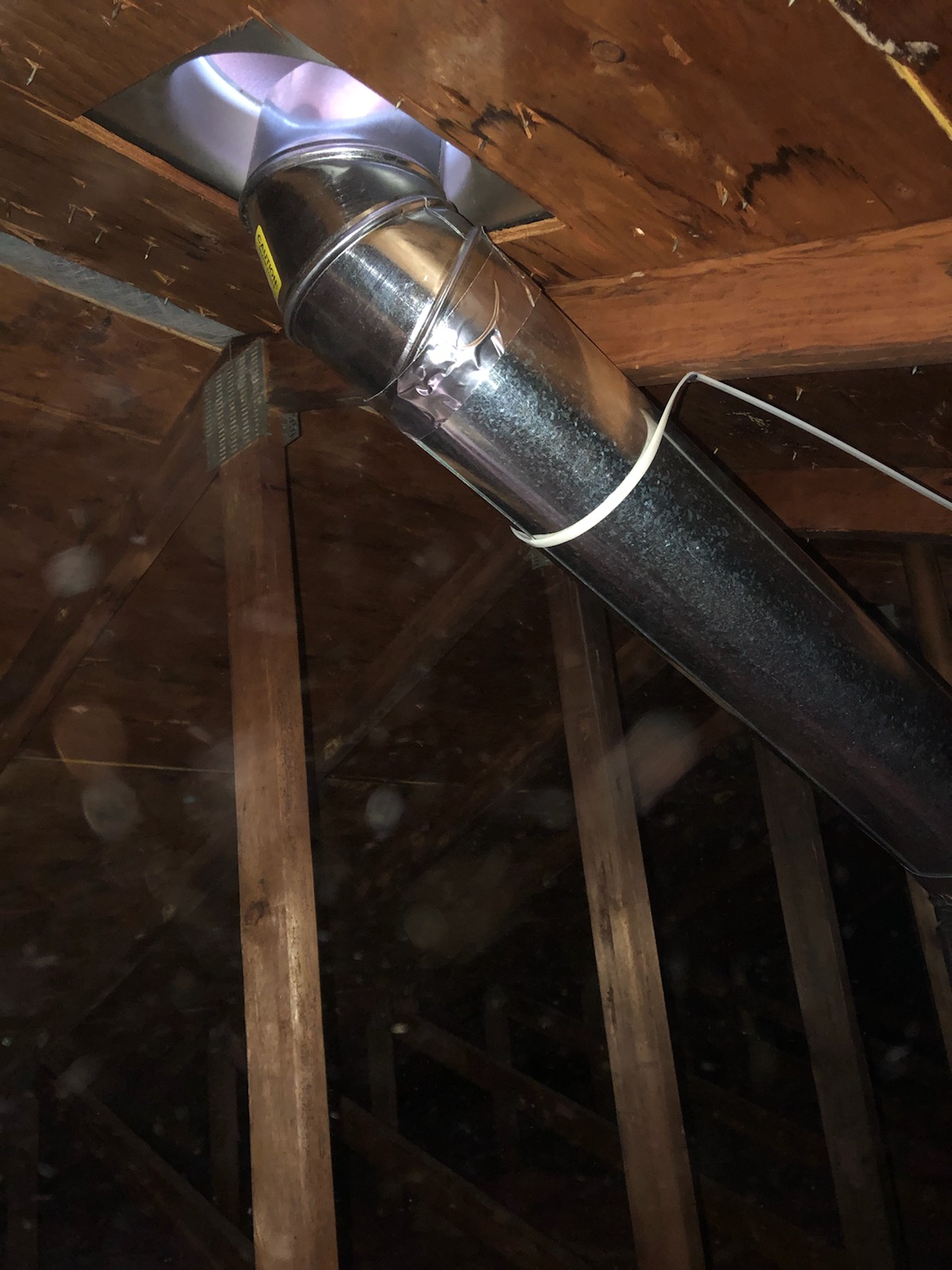 an existing attic exhaust pipe