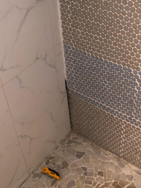 gap in the corner of the shower