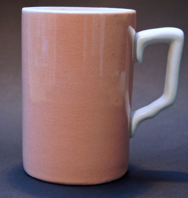 pink ceramic drinking vessel with handle, large enough to hold a pint or roughly 500ml or liquid
