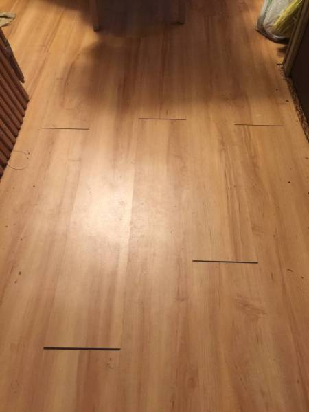 The vinyl plank click flooring I installed in two rooms develops     enter image description here