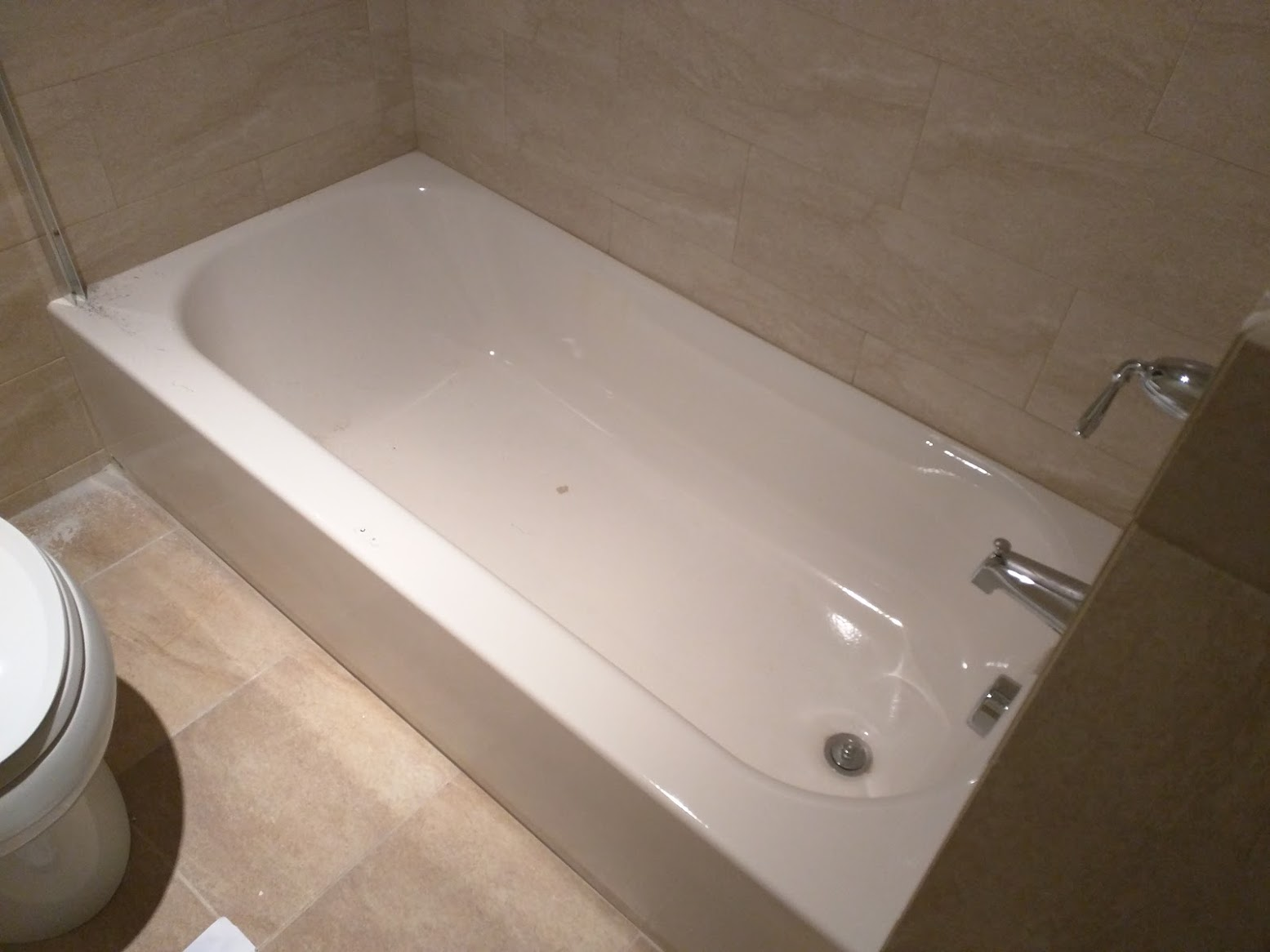 Drill Drilling Into A Bathtub Home Improvement Stack