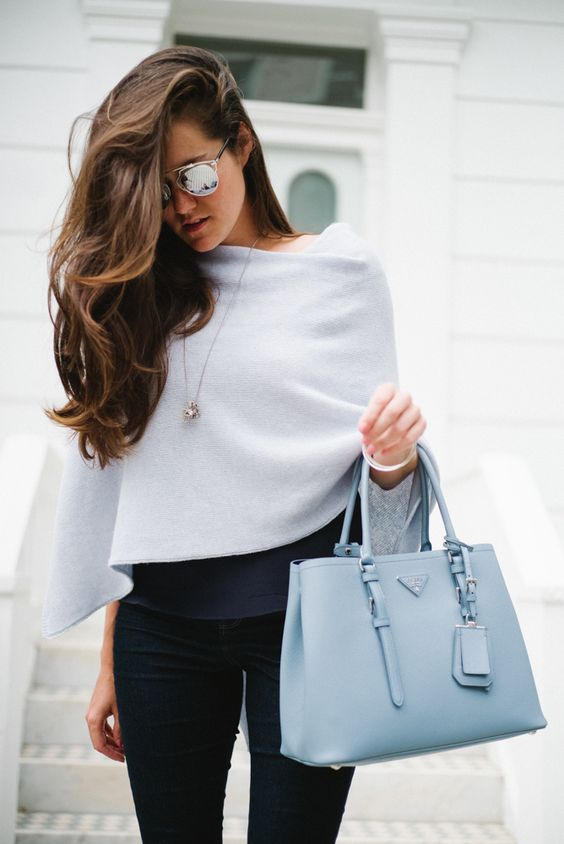 Picture Of Navy Jeans A Powder Blue Bag And A Light Blue