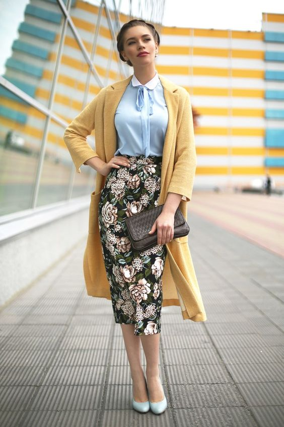 a blue shirt, a yellow long cardigan, a floral print midi pencil skirt, powder blue heels and a clutch