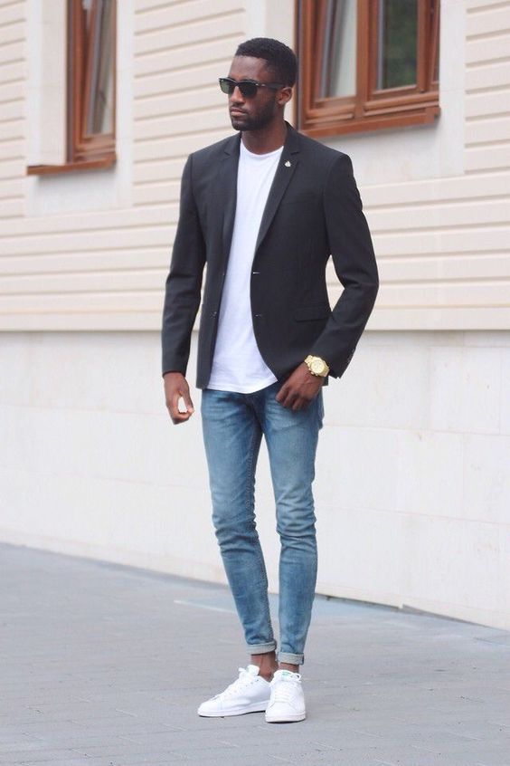 a minimalist look with a white tee a black blazer bleached jeans white sneakers for the fall