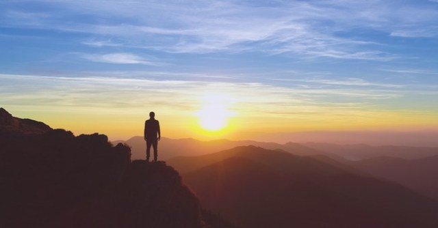 man gazing at sunset on mountaintop psalms for comfort