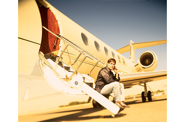 Mark Cuban, w/ his Gulfstream (Time Magazine)