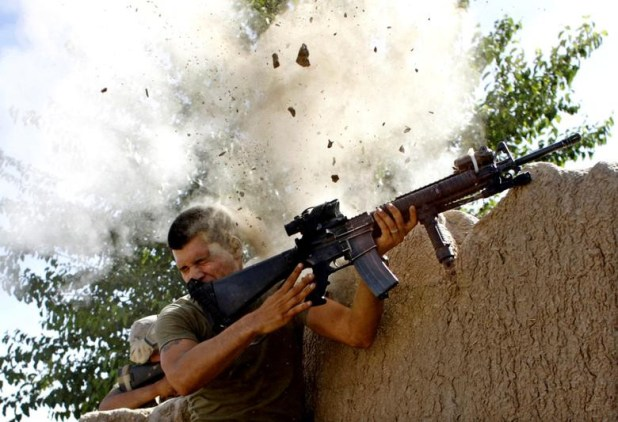 Sgt. William Olas Bee, a US Marine from the 24th Marine Expeditionary Unit, has a close call after Taliban fighters opened fire near Garmsir in Helmand Province of Afghanistan, May 18, 2008. [Photo: Reuters]