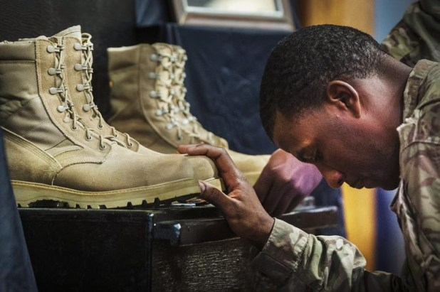 A US soldier from the 3rd Cavalry Regiment pays his respects during a memorial for Specialist Wyatt Martin and Sergeant First Class Ramon Morris at Bagram Air Field in the Parwan province of Afghanistan, December 23, 2014. Specialist Martin and Sergeant First Class Ramon were killed on December 12th by an improvised explosive device while on patrol near Bagram Air Field. [Photo: Reuters]