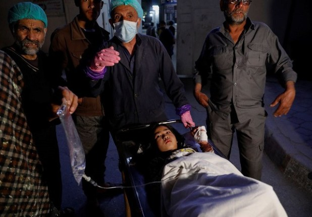 An injured school girl waits for a transport from one hospital to the other, after a blast in Kabul, Afghanistan May 8, 2021. PHOTO: REUTERS