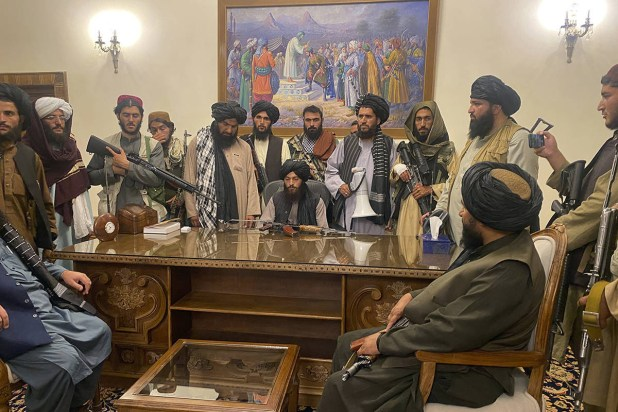 Taliban fighters pose in Afghanistan's presidential palace. [File Photo]