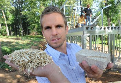27bec49d0 In Asheville, N.C., Anthony Brenner holds a handful of industrial hemp  shiv, left, and a block of the finished hardened product after the shiv is  mixed with ...