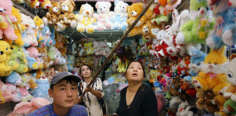 Shoppers in Kyrgyzstan's second-largest city, Osh, can find Chinese toy vendors in the market. Cheap Chinese goods have turned many poor Central Asians into consumers. But some experts say dependence on Chinese products slows the growth of local industries.
