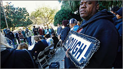 Michael Andrews of New Orleans attends a reading of the names of murder victims outside of New Orleans City Hall on Jan. 11.
