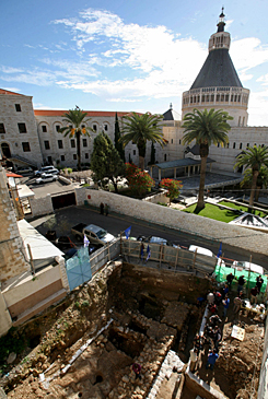 The Church of the Annunciation is seen Dec. 21 alongside the excavation site of the remains of the first dwelling in Nazareth, Israel, that can be dated back to the time of Jesus.