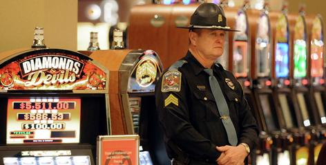 A state trooper stands inside VictoryLand in Shorter, Ala., in January. The gaming complex, which employed 1,600, closed to avert a raid by the state task force.