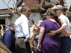 President Obama views damage from the tornado that devastated Joplin, Mo., with residents on Sunday.