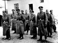This photo made available by Yad Vashem Photo Archive in Jerusalem shows Nazi guards at Belzec death camp in occupied Poland in 1942.