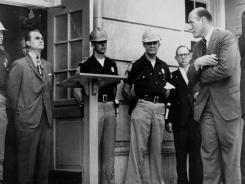 In this 1963 photo, U.S. Deputy Attorney General Nicholas Katzenbach, at right, confronts Alabama Gov. George Wallace, standing in front of a door to keep blacks from enrolling at the University of Alabama in Tuscaloosa, Ala.