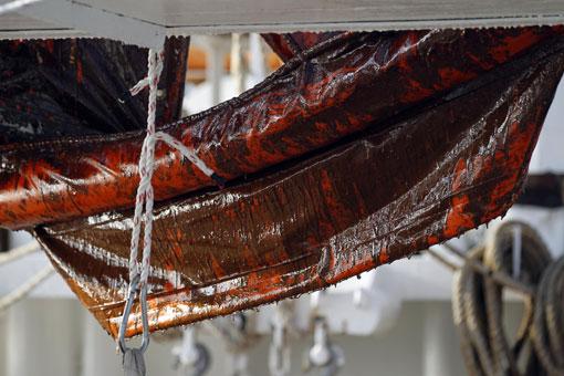 Oil covers booms hanging on the shrimp boat Mariah Jade in Breton Sound,     *   By Alex Brandon, AP     *       Taken: 5/6/2010