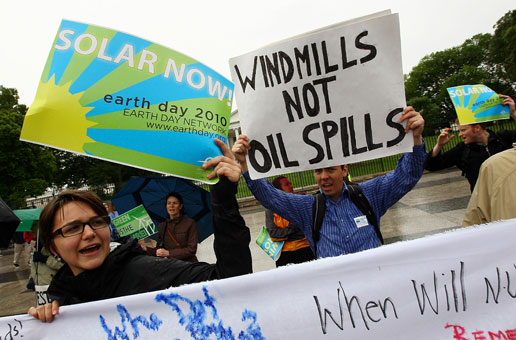 Environmental activists hold a rally in front of the White House to protest offshore drilling and voice their support for alternative sources of energy.